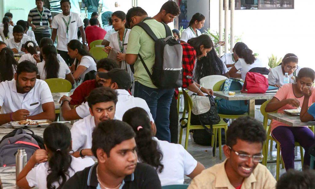 Indian students having food in UV Gullas Medical college hostel