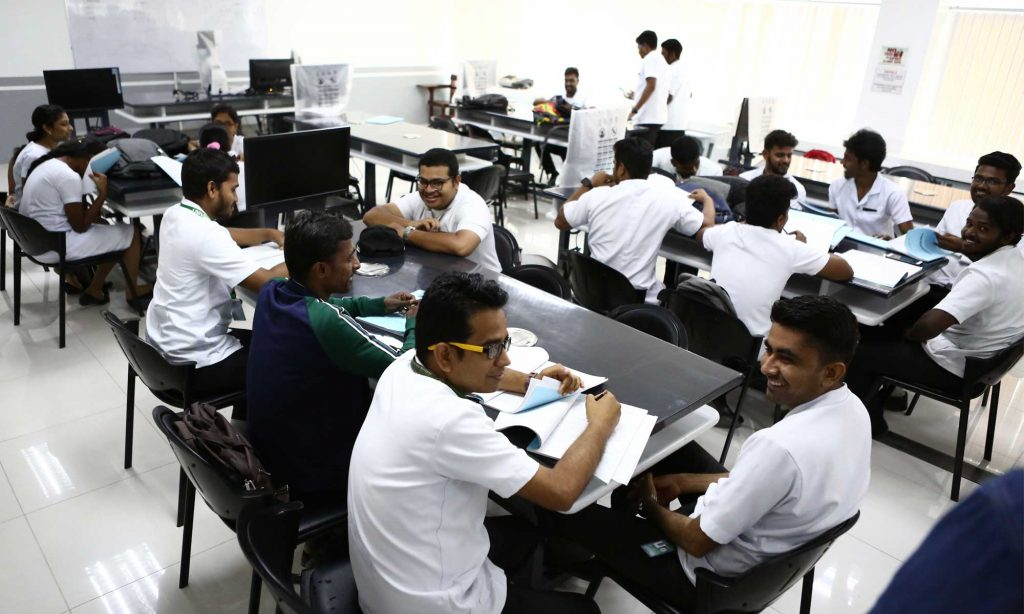 Indian Students in Best Philippines Medical University college premises preparing for exam.